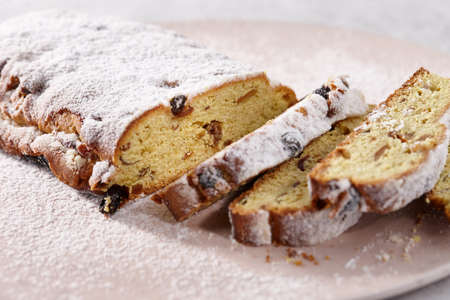 Traditional Christmas stollen dessert with candied fruit. Holiday winter bread. Standard-Bild