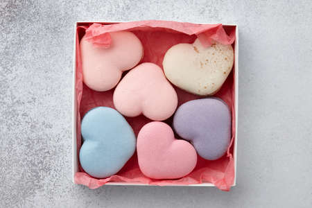 Heart shaped macarons in gift box for Valentines Day, pastel colors