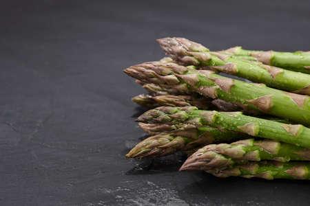 Fresh green asparagus on stone background, close up view Standard-Bild