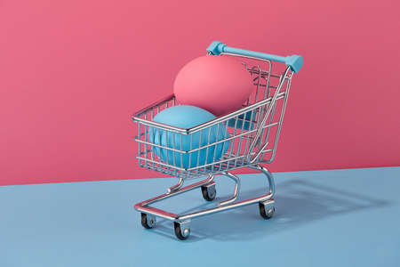 Colorful Easter eggs in shopping basket, holiday concept