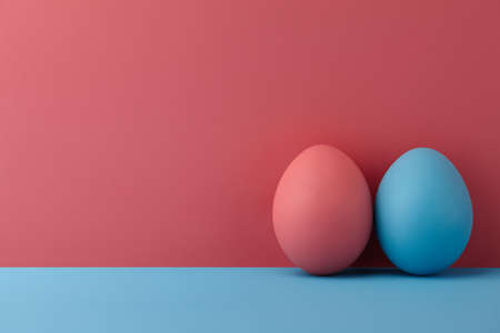 Painted Easter eggs on pink and blue background, copy space Standard-Bild