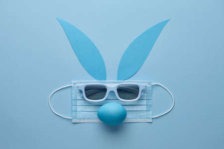 Easter bunny rabbit made from face mask and sunglasses. Holiday creative concept.