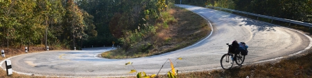 Bicycle on Slope Down Hill Country Road, Panorama Landscape.Meahongson province,Thailand. photo