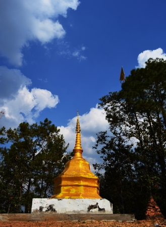 gloden: Gloden Phra That on Hill above Village Series 1_3, Buddha Image, Cloud and Blue Sky, Chiang Mai province, Thailand Stock Photo
