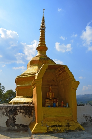 Golden Phra That on Hill above Village Series 1_2, Buddha Image, Cloud and Blue Sky, Chiang Mai province, Thailand