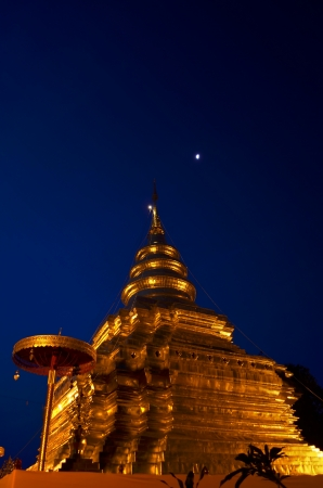 Phra That Sri Jom Thong  Before Sunrise, Series 1_11, Golden Pagoda on Spot Light under Moon, Chiang Mai province, Thailand