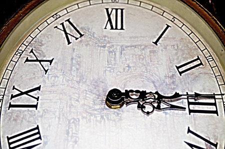 The vintage classic clock hang on the wall. Stock Photo