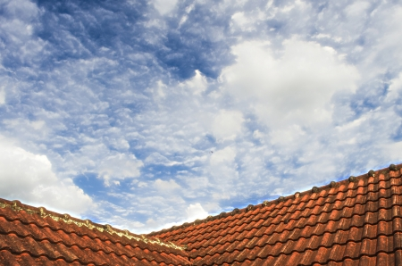 The Tiled Roof with Fluffy Cloud Blue Sky