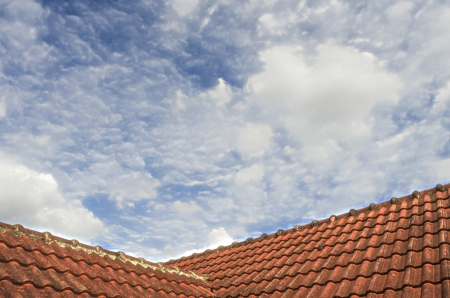 The Tiled Roof with Fluffy Cloud Blue Sky 105 photo