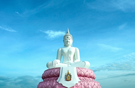 The White Seated Buddha Image of Subduing Mara Attitude with Blue Sky Stock Photo