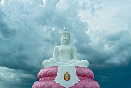 subduing: The White Seated Buddha Image of Subduing Mara Attitude with cloudy Sky