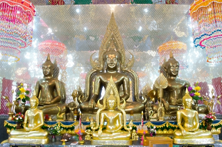 subduing: The Seated Buddha Images in Attitude of Subduing Mara and Meditation with Arch frame.