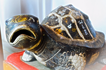 The Rock Turtle with Mystic Symbol,Thai believe that It Make Us Healthiness and Long Life. Stock Photo