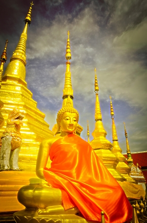 The Gloden Seated Buddha Image in Attitude of Meditation and Golden Pagoda. Stock Photo - 23110304