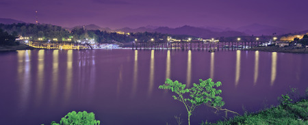 The calm lake on the night with lights  Stock Photo