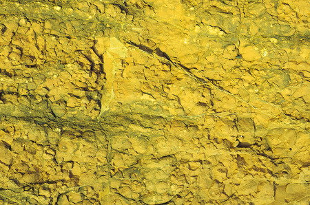 The rock in yellow face texture  Stock Photo
