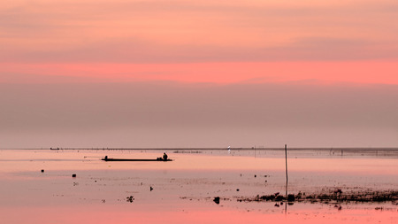 The Fisherman Boat and Peaceful Sea in Morning.