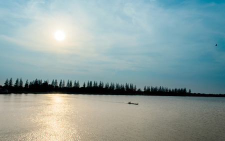 The Fisherman Boat and Morning Sunrise on River in Thailand.