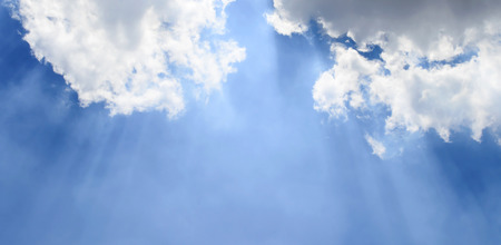 The Sunbeam and Cloudy Blue Sky. Stock Photo