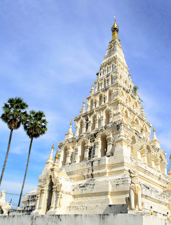 The Ancient White Square Pagoda at a Buddhist Temple in Thailand. Stock Photo