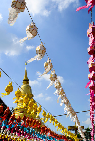 The Colorful Hanging Paper Lantern and Golden Pagoda in Festival of Thailand. Stock Photo