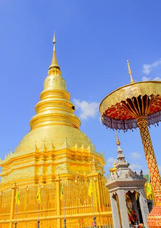 The Golden Pagoda and blue Sky at Wat Phra Tad Haripunchai,Thailand. Stock Photo