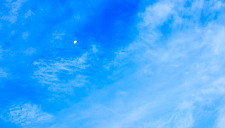 The Moon and Bright Cloudy Blue Sky.