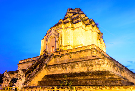The Ancient Pagoda of Thai Buddhist Temple in Twilight.