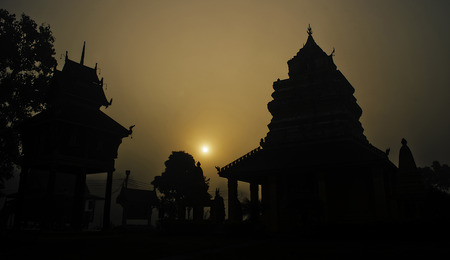 The Silhouette of Thai Buddhist Pagoda in the Morning Sun.