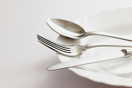 dessert plate: Fork, Spoon and Table Knife on the white background