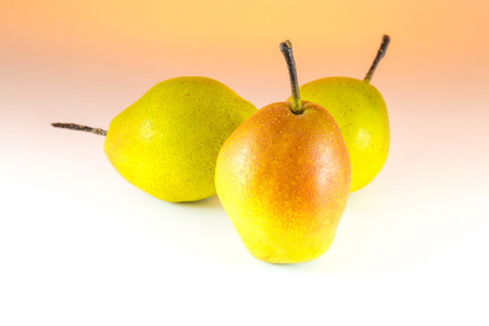 Pear on the white and orange  background photo