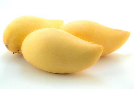 Yellow mangos on white background