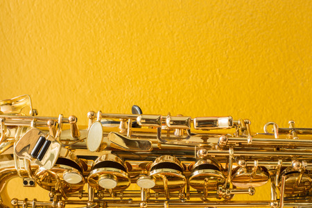 Saxophone on the yellow background