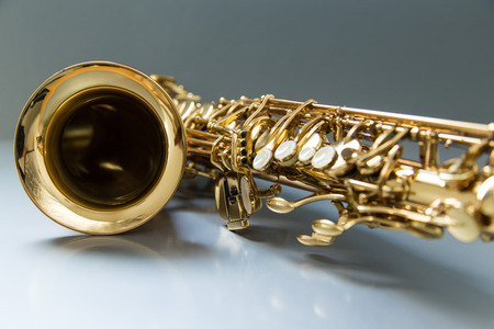 Saxophone on the gray background photo