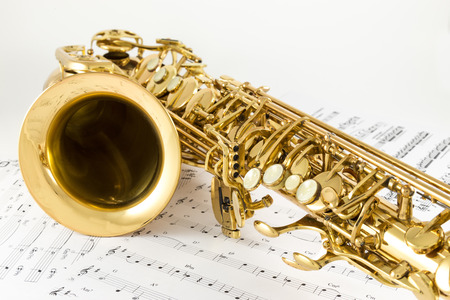 woodwind instrument: Saxophone on the white background