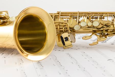 Saxophone on the white background photo