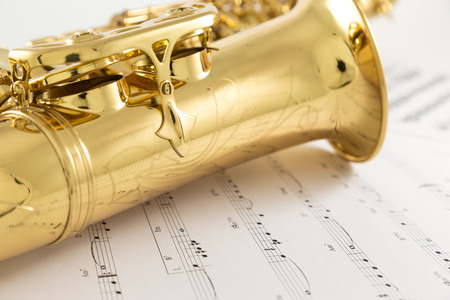 musical instrument parts: Saxophone and music note