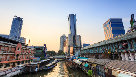 water transportation: Bangkok, Thailand - February 8, 2015: Skyscraper and Pratunam pier in Bangkok; water transportation by speed boat is one of the alternative choice for solving the traffic congestion problem in Bangkok. Editorial