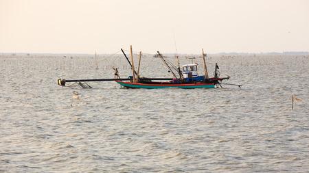 chonburi: Chonburi, Thailand - March 7, 2015: Unidentified fishermen are working in fishery area, Bangsai, Chonburi Province. Editorial