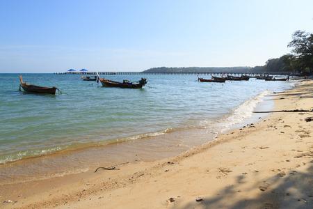 phuket province: Phuket, Thailand - 30 March, 2015: Unidentified Fishermen are preparing their ship and children are enjoying on the beach at Rawai beach, Phuket province Thailand.