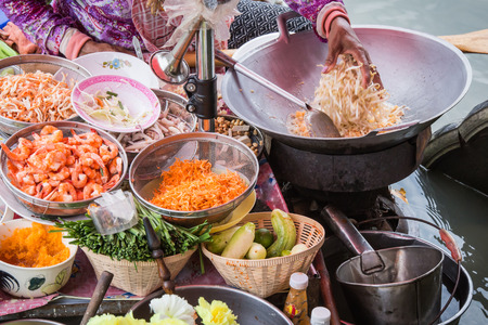 thai culture: Pad Thai cooking on the boat in Amphawa floating market