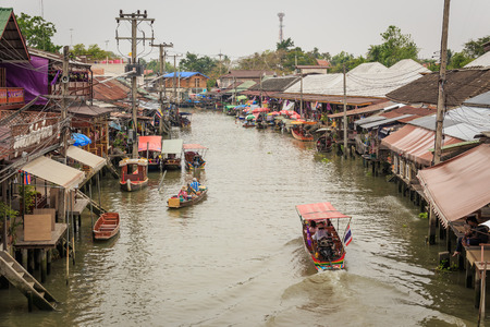 amphawa: Amphawa, Thailand - April 13, 2015: Amphawa Floating Market one of the famous tourist attractive place in Samutsongkram province. Unidentified tourists enjoy shopping and eat traditional Thai food along the canal.