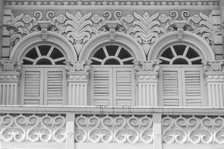 social history: Retro wooden windows and decoration of Chino-Portuguese style architecture in Phuket, Thailand Stock Photo