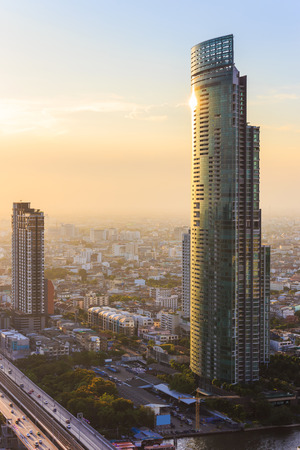 silom: Bangkok, Thailand - April 18, 2015: Sathron in the evening, one of the most significant business areas in Thailand. Its located on the Bangkok downtown. Editorial