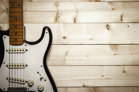Old electric guitar on the wood background with space Banque d'images