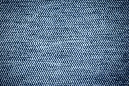 mezclilla: Textura azul de mezclilla denim y el fondo Foto de archivo