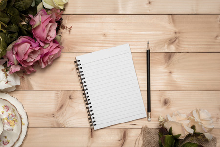 wooden pencil: Notepad with pencil on the wood background, vintage style Stock Photo