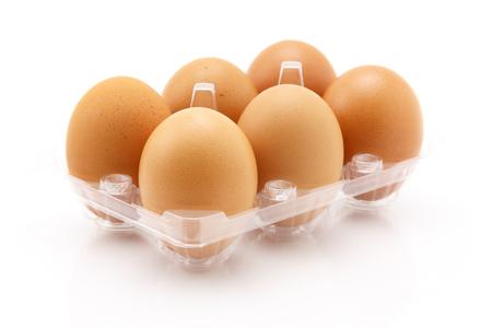 Six eggs isolated on white background, close up shot