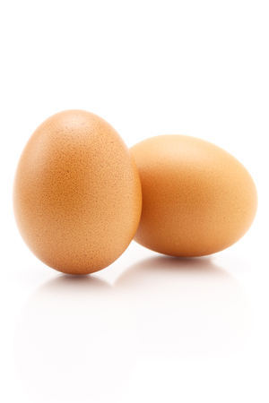 Two eggs isolated on white background, still life
