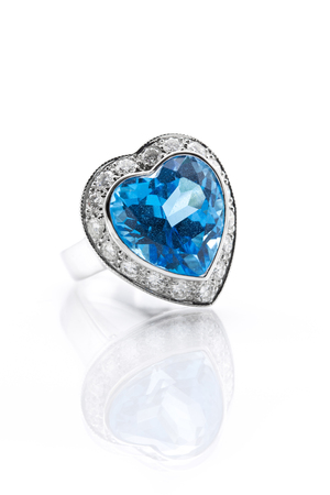 topaz: Blue topaz in heart shape surrounded with diamond ring